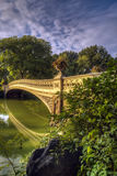 Central Park, New York City now bridge. Central Park, New York City Bow bridge in latye summer Royalty Free Stock Image