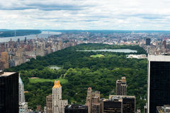 Central Park New York City. Central Park in New York City and a view of the skyline, downtown, and skyscraper office buildings. New York is a popular travel Royalty Free Stock Photo