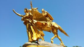 Central Park New York. Golden statue at the entrance to central park Royalty Free Stock Photos