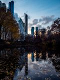 Central Park New York Reflection. Little Lake in Central Park with Buildings reflected during sunset royalty free stock images