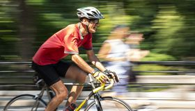 Riding bike fast with blurred background stock photos
