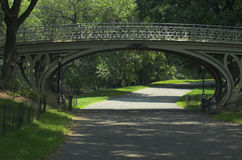 Central Park Path and Bridge. Over the bridge or under it on the path, Central Park is an amazingly beautiful getaway in New York City Stock Image
