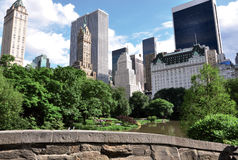 Central Park pond with buildings stock photos