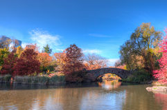 Central Park's Gapstow Bridge over The Lake in the fall Royalty Free Stock Images