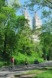 Central Park Spring. Central park in spring, New York City, USA. People running and riding bicycle in the park stock photography