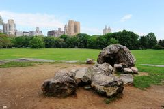 Central Park Spring. Central park in spring, New York City, USA. stones in grassland in the park royalty free stock photography