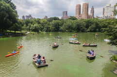 Central Park and Tourists Paddling Royalty Free Stock Photos