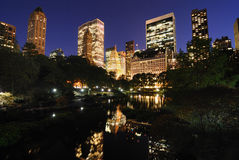 Central Park at Twilight. View of Central Park and New York City skyline Stock Images
