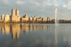 Central Park West. Luxury buildings on Central Park West, reflected on the Jacqueline Kennedy Onassis Reservoir stock image