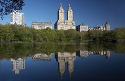 Central Park West Reflect. Reflection of apartment buildings on Central Park West looking from the lake in central park during a sunny morning Royalty Free Stock Photos