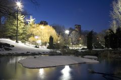 Central Park in winter. Central Park by Wollman rink and the pond in New York City Royalty Free Stock Image