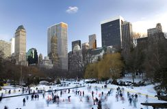 Central Park in winter. View of Central Park in front of Wollman rink with Manhattan buildings in rear view Royalty Free Stock Photography