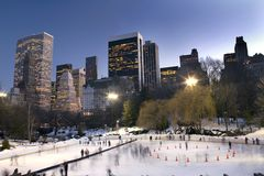 Central Park in winter. View of Central Park in front of Wollman rink with Manhattan buildings in rear view Royalty Free Stock Photos
