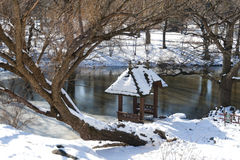 Central Park Winter Scene. Gazebo within Central Park with Snow and Tree Royalty Free Stock Image