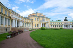 Central part of an ancient noble mansion in the cloudy July afternoon. Estate Maryino, Leningrad region Royalty Free Stock Photo