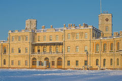 The central part of the Big Gatchina palace in beams setting the sun in the January evening. Gatchina Royalty Free Stock Image
