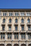 Central part of the facade, with statues, an important building in Trieste in Friuli Venezia Giulia (Italy) Stock Photos