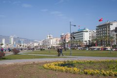 Central part of Izmir city, Turkey. Izmir, Turkey - February 5, 2015: Cityscape with modern buildings. Central part of Izmir city, Turkey, ordinary people walk royalty free stock image