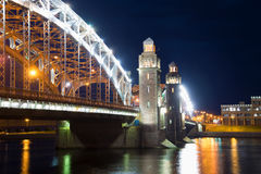 The central part of Peter the Great Bridge close up in night illumination. St. Petersburg, Russia Royalty Free Stock Photos