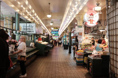 Central passageway of Pike Place Market early Saturday morning Stock Photos