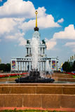 Central pavilion, exhibition center on the blue sky background. Fountain. ENEA,VDNH,VVC. Moscow, Russia. Stock Photos