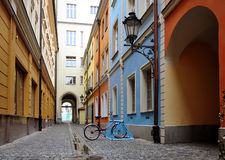 Central pedestrian street with old houses. The narrow central pedestrian street with colorful old houses and a parked bicycle. Wroclaw, Poland Stock Photos
