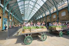 Central Piazza Convent Garden with Flowers on cart  in Foreground Royalty Free Stock Photo