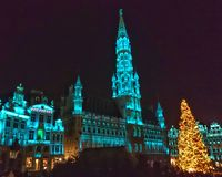 Central place. Light three Christmas Plaza building architecture tower city town evening night structure tourism tourist Royalty Free Stock Photography