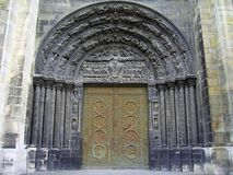 The Central Portal, Saint Denis Basilica, Paris. Above the elaborate bronze doors of Saint Denis` central portal, the tympanum and lintel show the iconography of Royalty Free Stock Images