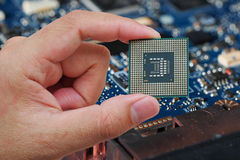 Central Processing Unit (CPU) in hand Stock Photo