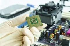 Central Processing Unit (CPU) in hand. Check and fix PC hardware Stock Photos