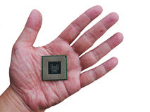 Central Processing Unit (CPU) in hand isolated on white. Background Royalty Free Stock Photo