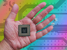Central Processing Unit (CPU) in hand on printed green computer. Central Processing Unit (CPU) in hand on printed green circuit board Royalty Free Stock Photography