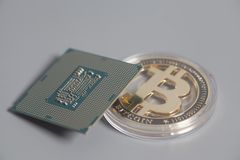 Central processing unit CPU microchip with Bitcoins. On gray stock images