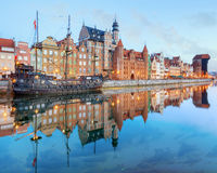 Central quay of Gdansk, Poland. Gdansk Long Bridge embankment with medieval wooden ship and Zuraw Crane, Baltic coast, Poland royalty free stock images