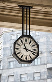 Central railway station. Clock on central railway station of Milan in Italy Stock Photos