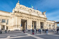 Central railway station in Milan, Italy. Milan, Italy - December 1, 2016: Milan central train station building  Stazione Centrale with people in front of the Stock Photo