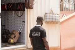 Unidentified Ghanaian man in black shirt from behind in local v. CENTRAL REGION, GHANA - Jan 17, 2017: Unidentified Ghanaian man in black shirt from behind in stock photos