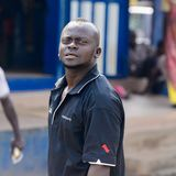 Unidentified Ghanaian man in black shirt looks ahead in local v. CENTRAL REGION, GHANA - Jan 17, 2017: Unidentified Ghanaian man in black shirt looks ahead in royalty free stock photography