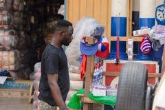 Unidentified Ghanaian man in black shirt looks down in local vi. CENTRAL REGION, GHANA - Jan 17, 2017: Unidentified Ghanaian man in black shirt looks down in stock image