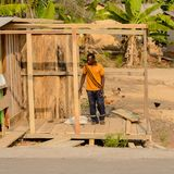 Unidentified Ghanaian man in orange shirt looks down in local v. CENTRAL REGION, GHANA - Jan 17, 2017: Unidentified Ghanaian man in orange shirt looks down in royalty free stock photography