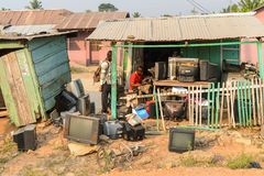 Unidentified Ghanaian man repairs electronic devices in local v. CENTRAL REGION, GHANA - Jan 17, 2017: Unidentified Ghanaian man repairs electronic devices in royalty free stock photo
