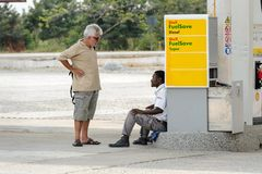Unidentified Ghanaian man speaks to the tourist in local villag. CENTRAL REGION, GHANA - Jan 17, 2017: Unidentified Ghanaian man speaks to the tourist in local royalty free stock photo
