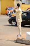 Unidentified Ghanaian man in yellow suit from behind in local v. CENTRAL REGION, GHANA - Jan 17, 2017: Unidentified Ghanaian man in yellow suit from behind in stock photo