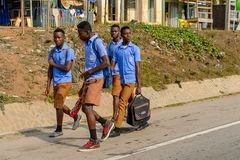 Unidentified Ghanaian pupils in school uniform walk along the s royalty free stock image