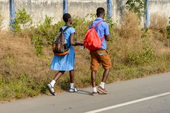 Unidentified Ghanaian pupils in school uniform walk along the s stock photos