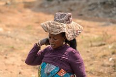 Unidentified Ghanaian woman in a hat with wide brim in local vi. CENTRAL REGION, GHANA - Jan 17, 2017: Unidentified Ghanaian woman in a hat with wide brim in stock photography