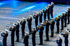 The  Central Russian Band of the Navy named after NA Rimsky-Korsakov at the Red Square. MOSCOW, RUSSIA - AUGUST 26, 2016: Spasskaya Tower international military Stock Photography