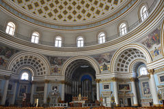 Central and side altars of the Parish Church of Santa Maria in Mosta, Malta. Stock Images