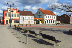Central square of Bauska town with benches and color old houses. Stock Image